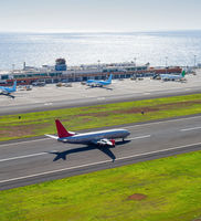 Airplane taking off Madeira airport