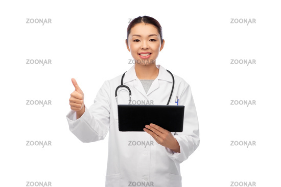 asian female doctor with tablet pc shows thumbs up