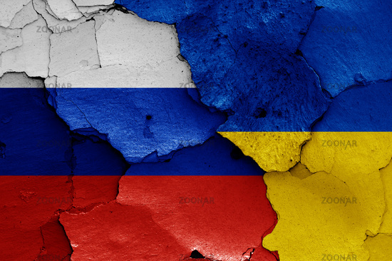 flags of Russia and Ukraine painted on cracked wall