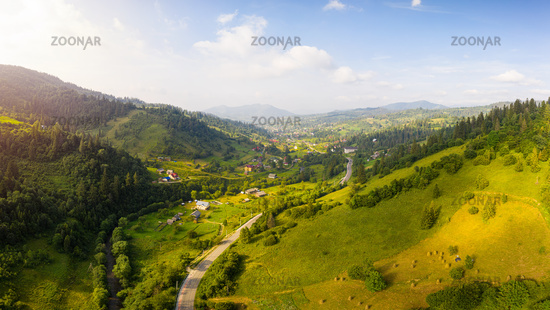 Scenic panoramic landscape. Aerial drone view of picturesque urban-type settlement in valley