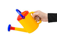 Hand with watering can