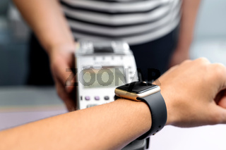 Top view of contactless payment with smart watch. Technology of paypass.