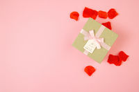 Pink background with present and rose leaves around