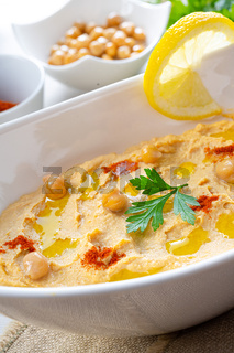 hummus paste with lemon and chilli on white background