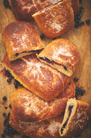 Tasty blueberry bun stuffed with fresh forrest fruits. Traditional polish bun called jagodzianka
