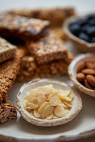 Close up of Almond petals. With various energy nutrition bars in background