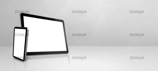 Mobile phone and digital tablet pc on white concrete office desk. Background banner