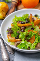 Salad with fried chicken liver and pears.