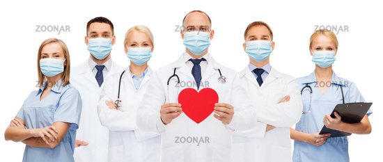 doctors in protective medical masks with red heart