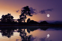 moon with lake reflections dark scenery