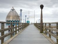 Sea bridge with a pier and jumping places in the summer . Old wooden bridge or pier at the sea.