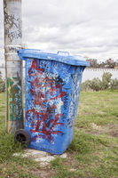 Blue Dustbin With the City in the Background