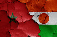 flags of Morocco and Niger painted on cracked wall