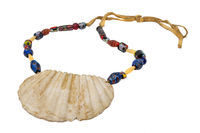 Indian necklace with a large seashell and old glass beads on a leather cord isolated on white