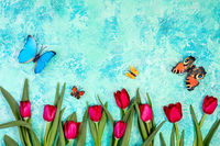 Red tulips and flying butterflies.