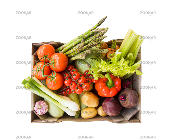Box of summer vegetables, isolated on white