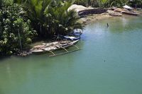 Traditional Outrigger Boat on the Riverbanks on Bohol Island