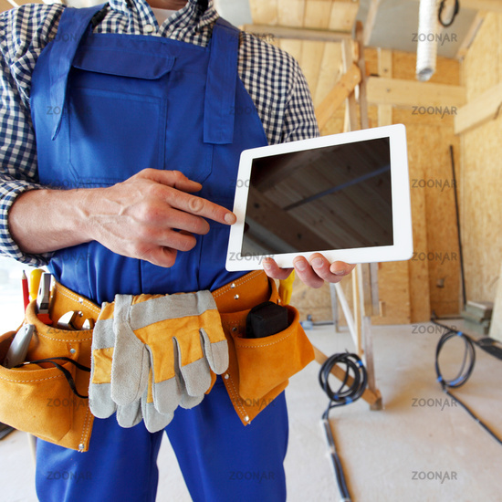 Worker pointing at blank tablet pc