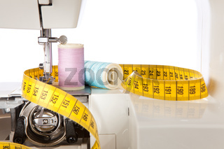 Sewing machine with Sewing threads and measuring tape