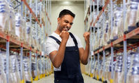 indian worker celebrating success at warehouse