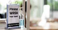 Hand Sanitizer with new normal and social distance office panorama