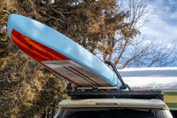 Unlimited racing stand up paddleboard on roof racks