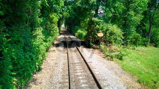 Rail Road Track going Thru Woods