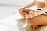 Slim woman meditating doing her yoga exercise