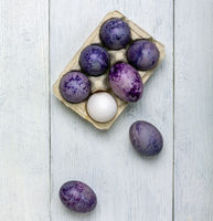 Egg box with easter eggs.