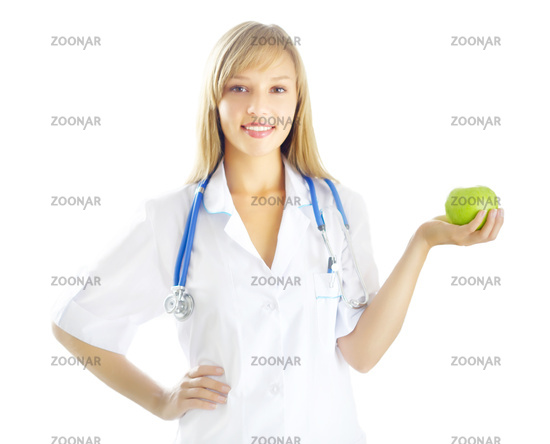 Portrait of a happy female doctor with green apple