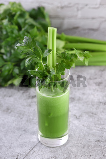 Glass of freshly made celery smoothie.