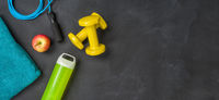 Fitness equipment on a dark background with copyspace
