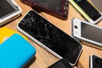 broken cellphone and broken display of smartphone - communication cellphone