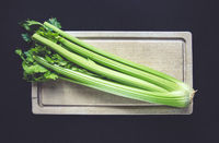 Celery branch bunch on a cutting board