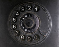 Rotary dial of an old telephone made of bakelite