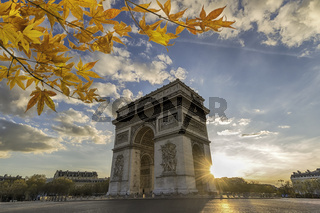 Paris France sunset city skyline at Arc de Triomphe and Champs Elysees with autumn leaf foliage