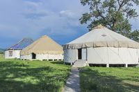 A row of traditional constructed yurts in Kalajun Grassland, Xinjiang, China