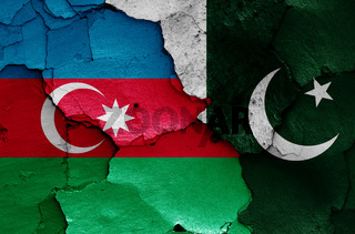 flags of Azerbaijan and Pakistan painted on cracked wall