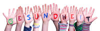 Kids Hands Holding Word Gesundheit Means Health, Isolated Background