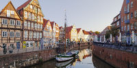Historic merchant's and warehouse houses, Hanseatic harbor with sailing ship, Stade, Germany, Europe