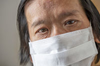 Corona pandemia: Asian male with mask