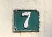 Vintage grunge square metal rusty plate of number of street address with number