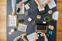 business team with gadgets working at office table