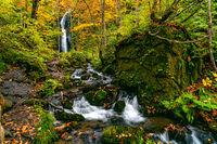 View of Komoi no Tagi waterfall in autumn season at Oirase Gorge