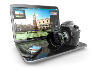 Photo camera, laptop and mobile phone. Journalist  or  traveler equipment.