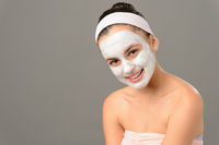 Smiling teenage girl cosmetics mask skin beauty