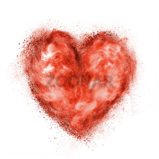 red heart made of black powder explosion isolated on white