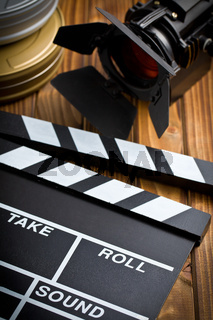 clapper board with movie light