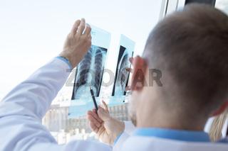 Doctors examining x-ray film