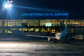 Plane of Ukrainian International Airlines company waiting for passengers at Lviv International Airport